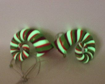 Pink, green, fuchsia and glowing in the dark twisted ram inspired horns with glitter
