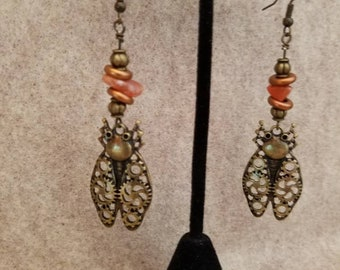 Steampunk Beatles Dangle Earrings with orange stone and metal beads