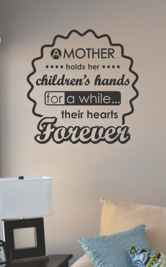 A Mother Holds Her Child Wall Decal by 	SlapArtDesign