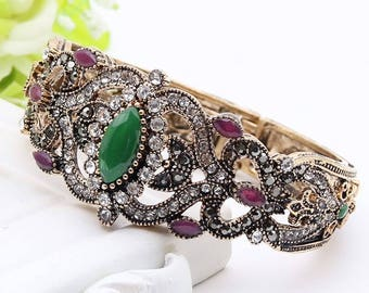 Ornate cuff bracelet, green and pink rhinestones with crystals, exquisite metal work