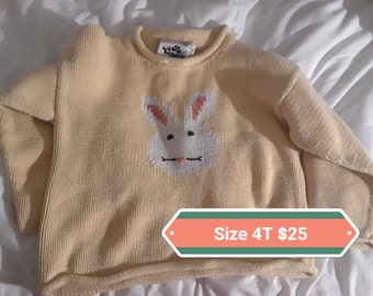 Child's yellow sweater with bunny