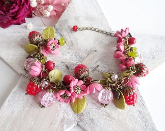 Flower bracelet and raspberries