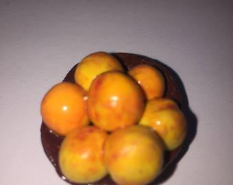 Handmade bowl of peaches