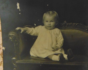 1920s Adorable Smile Baby seated on Velvet Chair Photograph Black and White