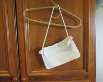 Hand crocheted shoulder bag in creamy off white cotton yarn