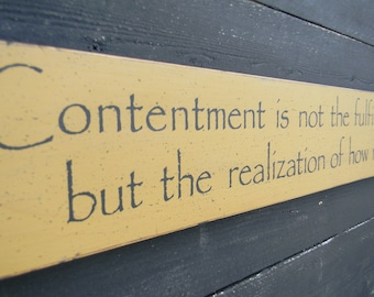 Contentment is not the fulfillment of what you want - wood sign