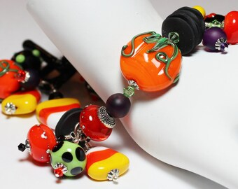 Practical Magic... Handmade Jewelry Bracelet Beaded Lampwork Crystal Cha Cha Halloween Orange Black Green Purple Silver Pumpkin Candy Corn