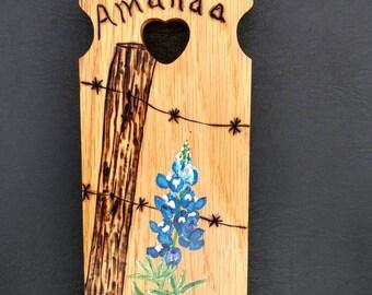Texas blue bonnet on wood