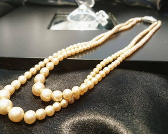 A pretty vintage 1950's double strand faux pearl necklace with ornate silver tone clasp, vintage faux pearls