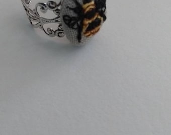 Hand embroidered bumblebee ring.