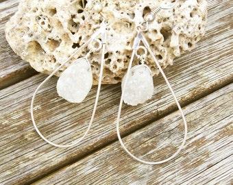 Silver ground crystal hoop earrings