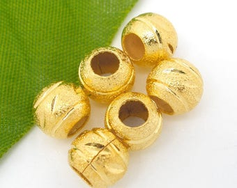 Round Golden etched copper beads.
