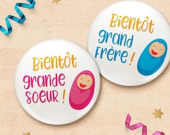 "Badge listing ""see you soon big sister"" or ""see you soon big brother"" pregnancy"