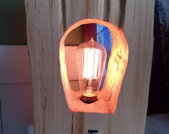 Carved rustic block of wood lamp featuring Edison bulb and toggle switch