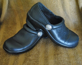 I Love Comfort reimagined black leather clogs embellished with Celtic design conchos by Wes Connell