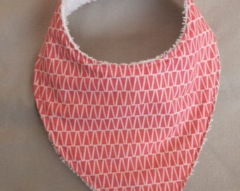 bandana bib in coral and double fabric with a white Terry cloth