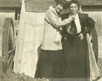 vintage photo 1912 Girl Encourages Woman Stick out Her Tongue Affectionate gals