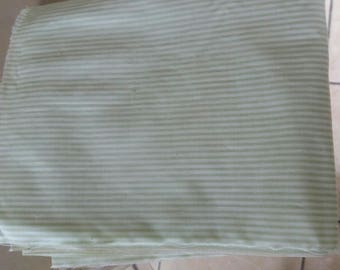 Lightweight fabric coupon thin pale green stripes