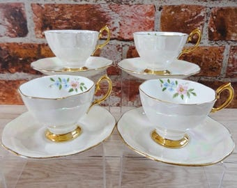 4 cups and saucer Pearl Lusterware Hand painted Flowers Bone China vintage