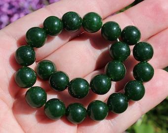 2 dark green 10 MM AAA round Emerald beads. TZ31
