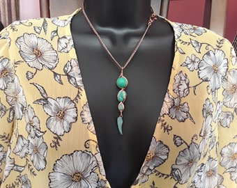 Howlite turquoise vertical pendant with copper wire wrapping on copper chain.
