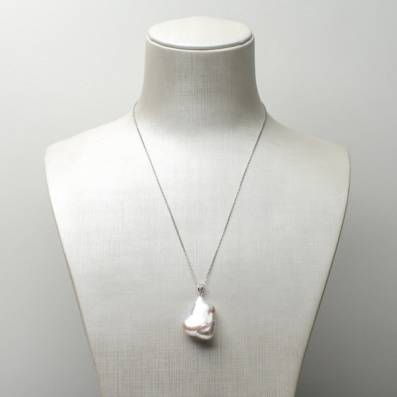 Lovely high platinum white lustre sterling silver large Keshi pearl pendant