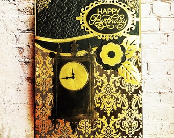 Black and gold card with clock