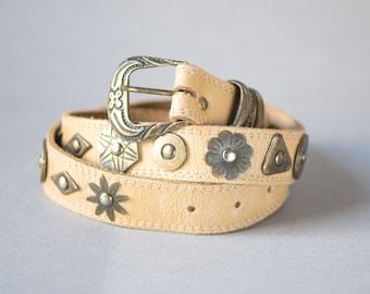 Vintage beige leather belt boho accents. Metal flowers coins rhombs details on waist belt. Genuine leather belt chunky. Festival belt women