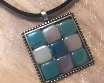 Geometric necklace with iridescent glass tiles on an antique silver pendant