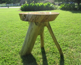 Rustic log accent table.