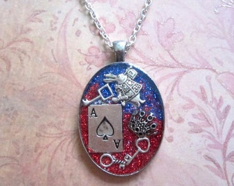 Alice: Madness Returns American McGee's Alice Drink me  Alice in Wonderland symbols resin pendant
