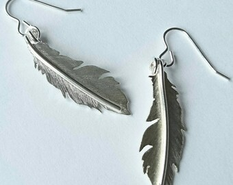 Sterling silver hand pierced feather earrings, hallmarked in Edinburgh.