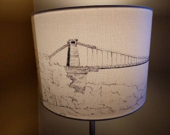 Hand drawn lampshade featuring a panoramic of Clifton Suspension Bridge from Avon Gorge