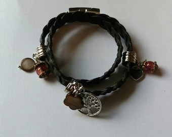 Dark brown leather braided wrap bracelet with charms.