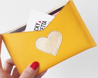 Leather clutch in Sunshine yellow and gold to store her papers/passport...