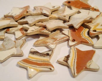 Hand-made ceramic star : white/yellow/red/brown, 3 cms