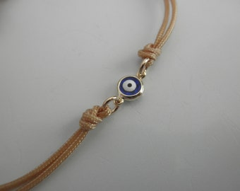 blue evil eye bracelet gold framed