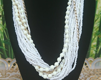 White Pearl Necklace and gold chain.