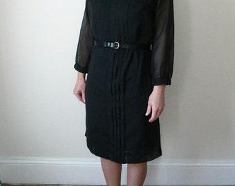 Black shift dress. 1960s black cotton knee length dress. Long sleeve cotton shift.