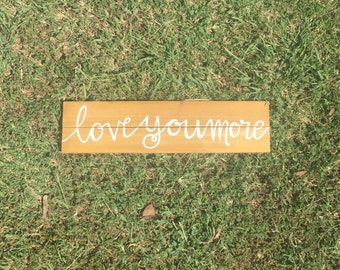 "Wooden handpainted ""Love you more"" sign"