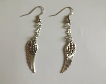 Dangling silver wings earrings