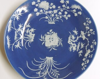 A Chinese porcelain plate blue glaze and white relief decorations
