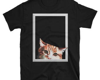 Orange tabby cat looking out T-shirt