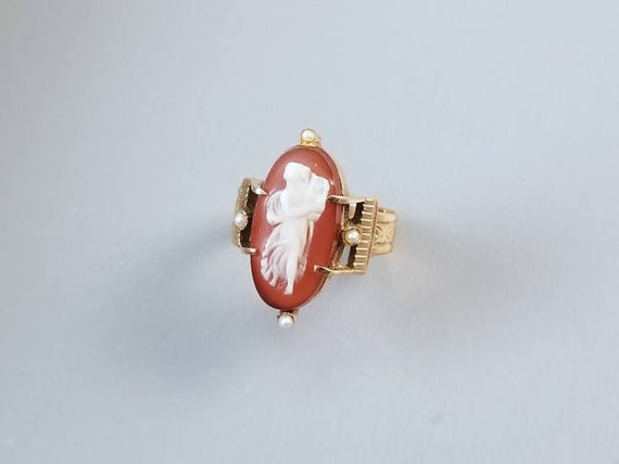 Antique Victorian rose gold hardstone sardonyx cameo seed pearl double buckle ring full body figural with lyre harp, size 6-1/4