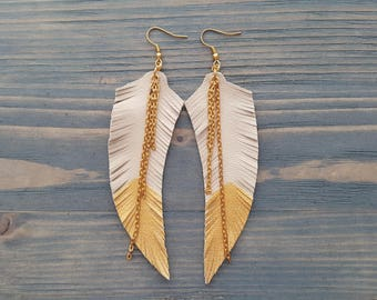 Gold feather earrings. Leather feather earrings. Long gold earrings. Gold dangle earrings. Beige earrings. Boho earrings. Bohemian earrings.