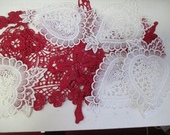 A mixture of red and white lace pieces. Approx 10 pieces.