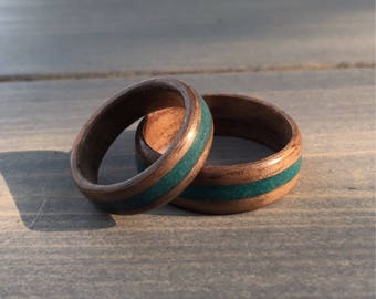 His and hers walnut wood ring set // walnut bentwood ring set with turquoise dyed sand inlay.