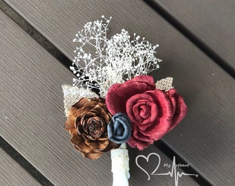 Burgundy & Gray Sola Boutonniere with Cedar Rose and Ivory Baby's Breath