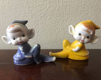 Two Ceramic Christmas Pixie Elves Yellow Blue