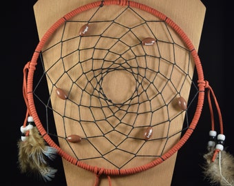 Large sized red wrapped dreamcatcher with football beads, white and black beads